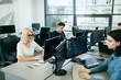 People Working In Modern Office.