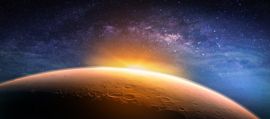 Fototapeta Landscape with Milky way galaxy. Sunrise and planet view from space with Milky way galaxy. (Elements of this image furnished by NASA)