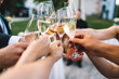 canvas print picture - People hold in hands glasses with champagne, friends celebrating and toasting