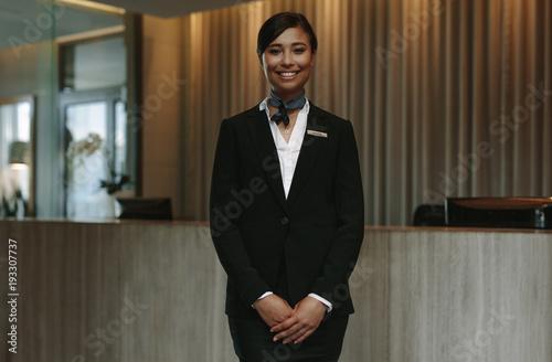 Fototapeta Beautiful concierge waiting for welcoming guests