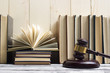canvas print picture - Legal Law concept - Open law book with a wooden judges gavel on table in a courtroom or law enforcement office. Copy space for text
