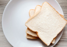Toasted Slice Of Bread On White Plate