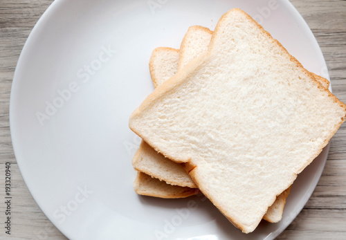 Foto Toasted slice of bread on white plate