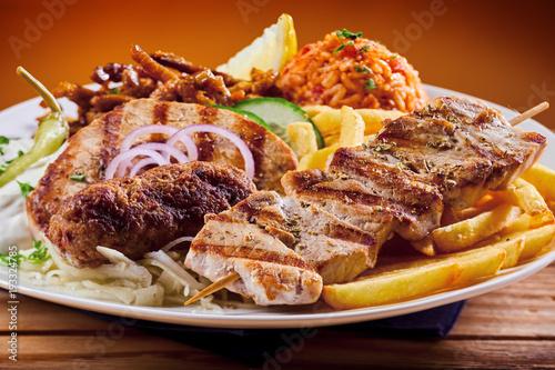 Papel de parede Greek grill plate with souvlaki and souzuki steak