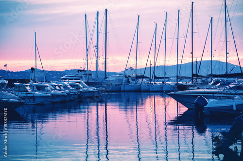 Fotografie, Obraz dock with white boats and yachts on a beautiful colorful sunset on the Cote d'Az