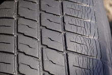 An Old Worn-out Tire Close, Ba...