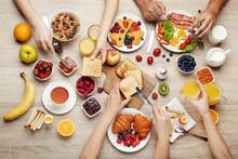 Happy Family Having Tasty Breakfast In The Morning