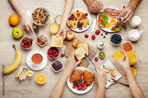 Obraz na plátně Happy family having tasty breakfast in the morning