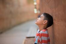 Little Boy Sitting Alone With Sad Feeling