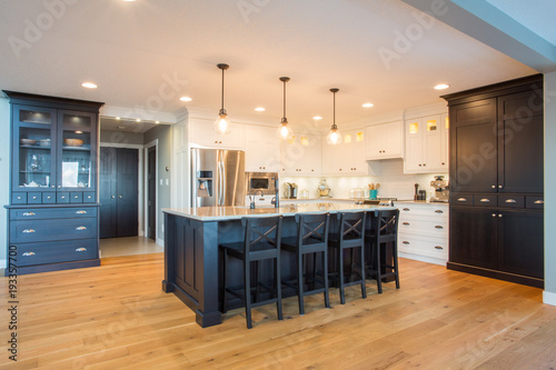 Custom kitchen with built in appliances, hard wood floors, and light and dark ca Wallpaper Mural