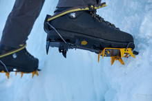 Crampons Close-up On His Feet ...