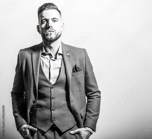 Handsome Young Elegant Man In Grey Jacket Pose Against Studio Background Black White Portrait Buy This Stock Photo And Explore Similar Images At Adobe Stock Adobe Stock