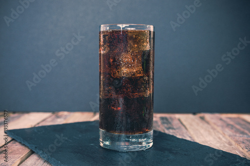 Glass of ice cold cola Canvas Print