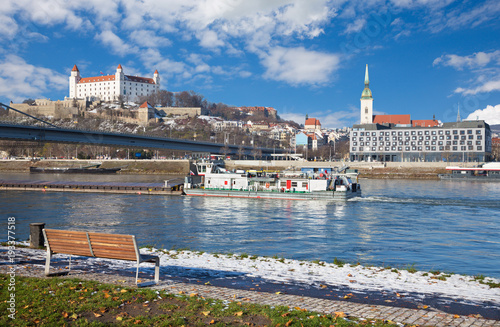 Bratislava - Scenery of the City with the promenade of Danube after first snow.