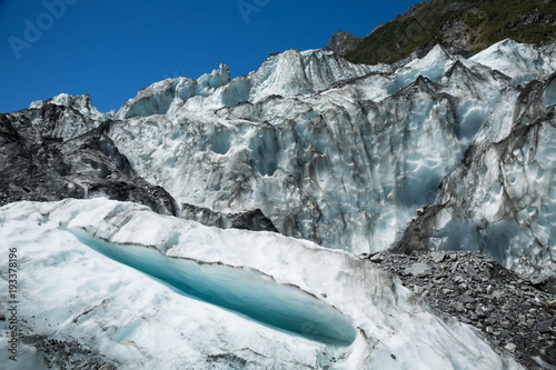 Valokuva  Small crevasse below seracs of an icefall on the Fox Glacier in New Zealand