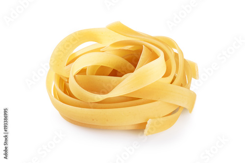 Fotomural  Raw tagliatelle pasta isolated on white background.