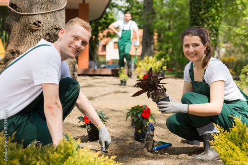 Obraz na plátně Professional gardening team starting their busy day