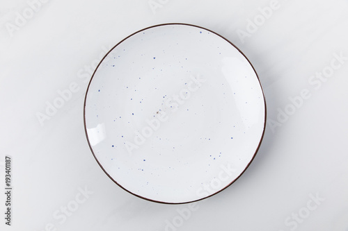 Stampa su Tela Top view image of plate placed on white surface, minimalistic conception