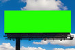Leinwandbild Motiv empty billboard with chroma key green screen, on blue sky with clouds, advertisement concept