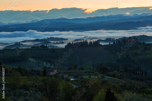 Keuken foto achterwand Zwart Landscape with a morning fog and vineyards in the vicinity of the city of San Gimignano, Tuscany