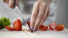 Female Culinary Expert Cutting...