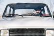 Man driving vintage car