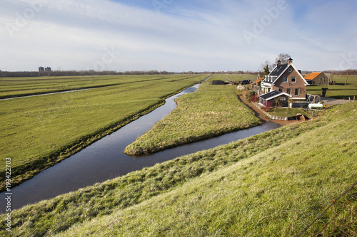 Dutch polder landscape with a farm and some houses Fototapeta