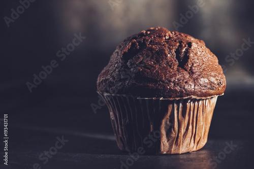 Fotografie, Obraz  Chocolate muffin, homemade bakery on dark background