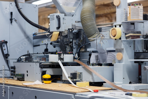 Fotografie, Obraz  veneer or edge banding machine at factory