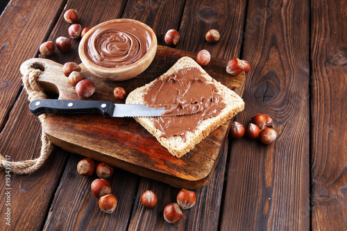 Homemade hazelnut spread with toast and in wooden bowl for breakfast Fototapete