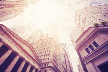 Fototapeta Looking up at the Wall Street buildings, color toned picture, New York City, USA.