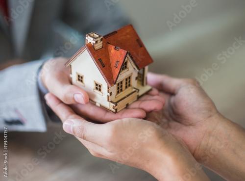 Selling home,Little house ,money Fototapeta