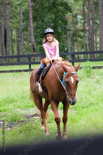 Photo  Little Girl Horseback Riding Lessons