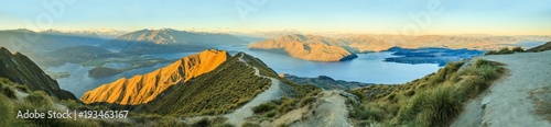 Poster Campagne Breathtaking, Stunning Panoramic Landscape View from Roys Peak on Lake Wanaka with golden sunshine light at twilight, South Island, New Zealand.
