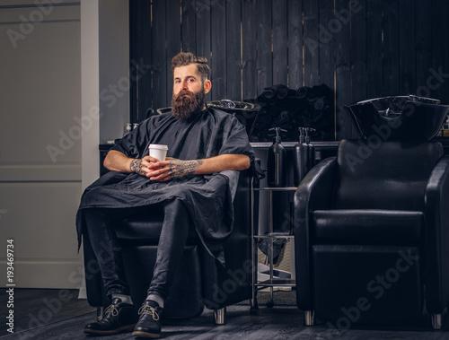 Fényképezés  Handsome bearded man in the barbershop.