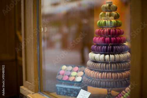Aluminium Prints Macarons Macarons in the shop window of a small shop of a bakery
