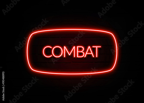 Fotografía  Combat neon sign on brick wall background.