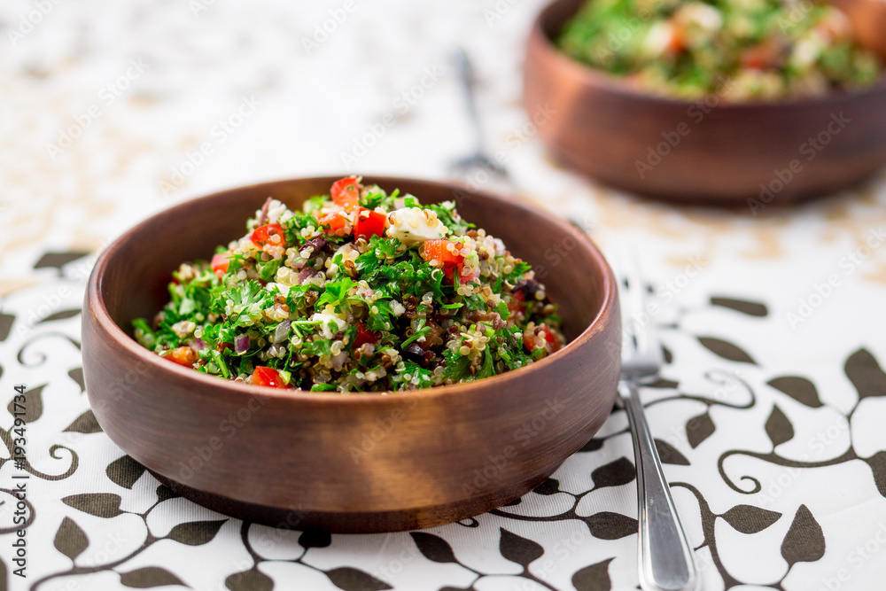 Fototapety, obrazy: Healthy vegetarian salad bowl. This healthy dish mixes tabbouleh & greek style salads, using fresh parsley herb, olives, onions, feta and replacing the bulgur usually found in tabouleh with quinoa.