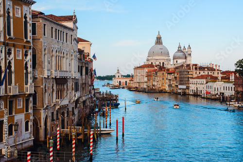 Fotografie, Obraz  Beautiful panoramic view over the famous Grand canal in Venice, surrounded by old and romantic architecture illuminated by sun, in Italy