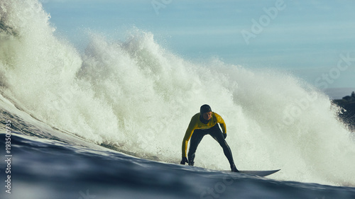 Man surfing in ocean against waves