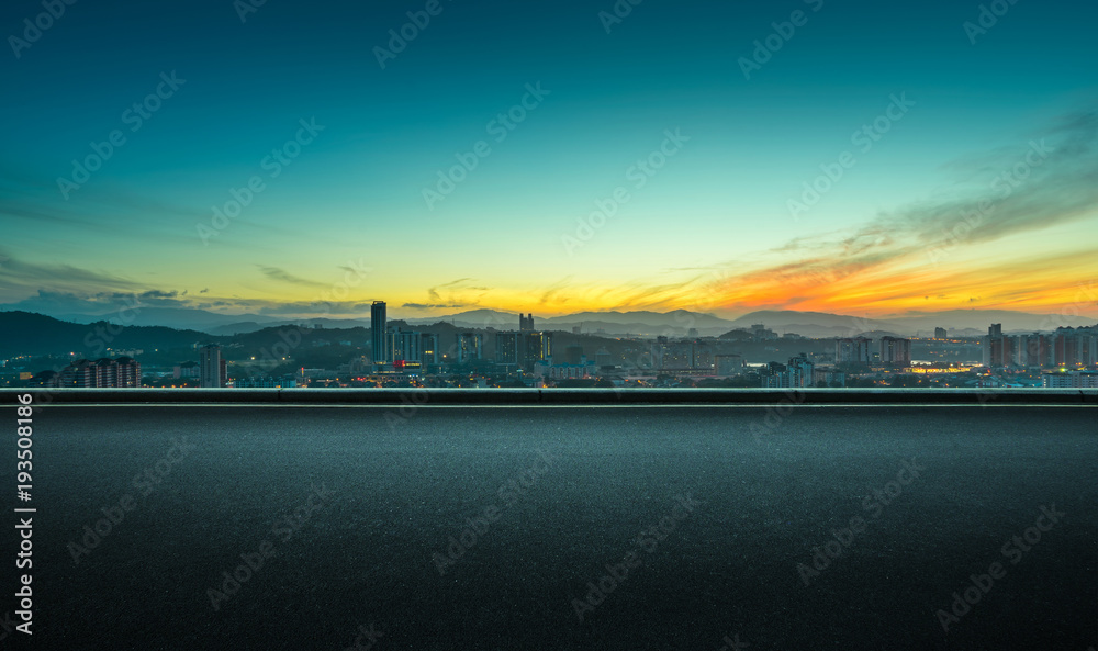 Fototapeta Asphalt empty road side with dramatic orange color sunrise sky background .