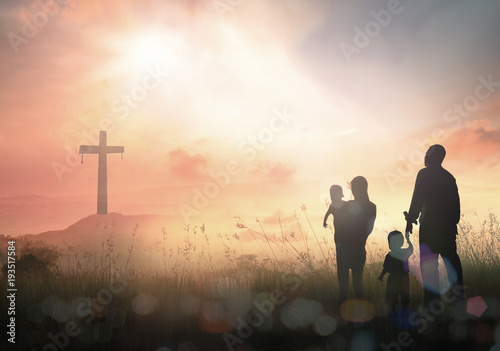 Fotografía  Ascension day concept: Silhouette people looking for the cross on autumn sunrise