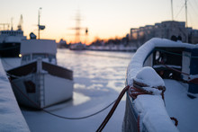 Selective Focus On Mooring Bollard On Boat Covered By Snow During Winter Sunset
