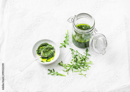 Arugula pesto on a light background, top view Fototapeta