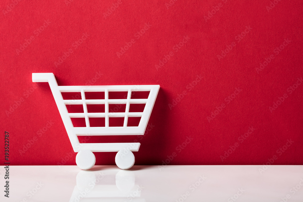Fototapety, obrazy: Close-up Of A White Shopping Cart