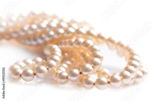 Pearl necklace on a white background