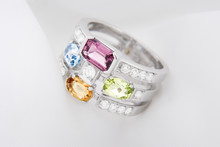 White Gold Ring With Citrine Peridot, Blue Topaz, Pink Tourmaline And Diamonds On Soft White Background