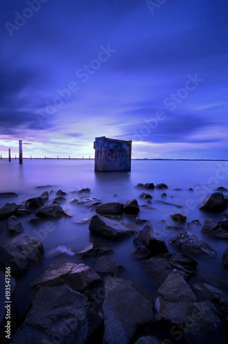 Recess Fitting Dark blue long exposure of sea and rocks