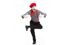 Funny Mime Performing On One Leg And Showing Thumbs Up Isolated On White