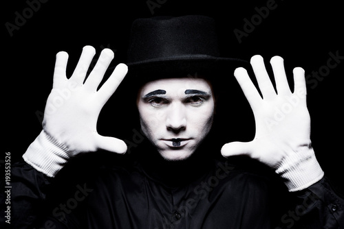 mime showing hands isolated on black Fototapet